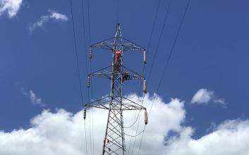 Worker on transmission tower